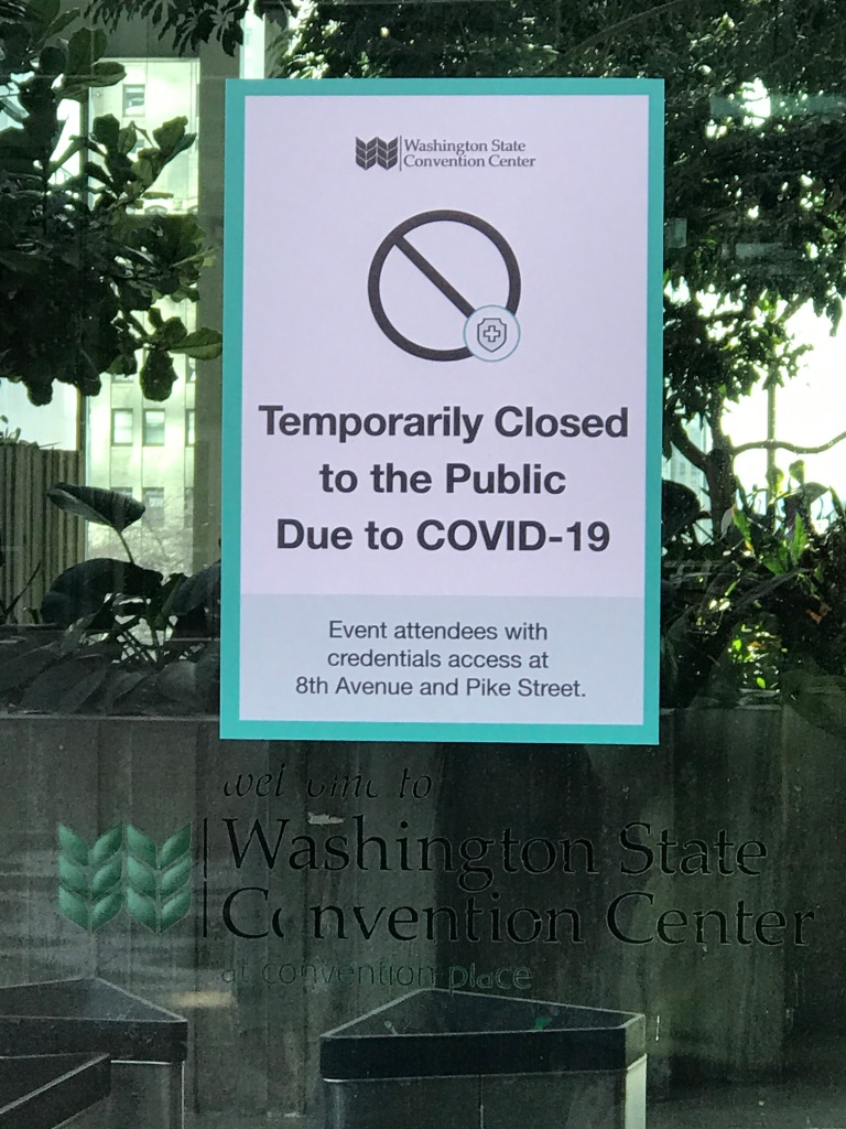 "Sign taped to window reading ""Temporarily Closed to Public"" Washington State Convention Center."